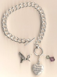 Silver bracelet with hummingbird
